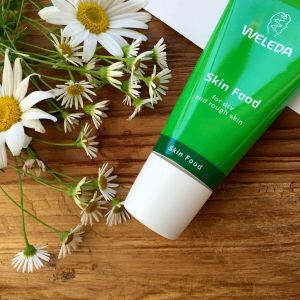 Weleda Skin Food with background of flowers